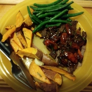 Sliced Steak Tagliata with Sweet Potatoes, Green Beans, and Tomato Vinaigrette finished plate