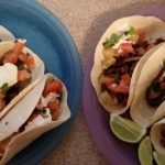 Pineapple Poblano Beef Tacos with Lime Crema, Cilantro and Warm Spices finished plates