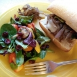 Melty Mozzarella Burgers Melty Mozzarella Burgers with Caramelized Onion and Balsamic Greens on Ciabatta finished plate