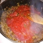 Tomato sauce added to beef