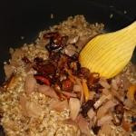 Mixing the farro salad