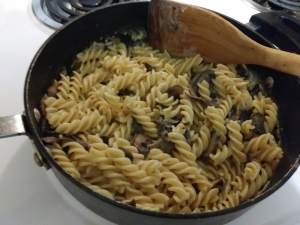 Add pasta to sauce