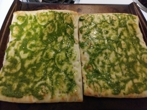 Spread pesto to cover flatbreads